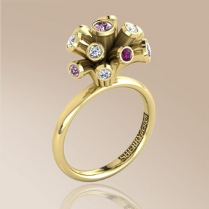 Pink sapphire and diamond high set ring with spray design