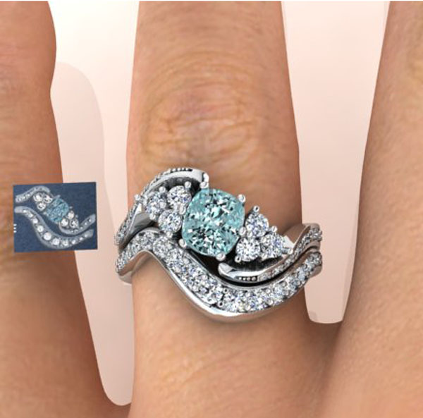 Blue diamond engagement and wedding ring set 600x593