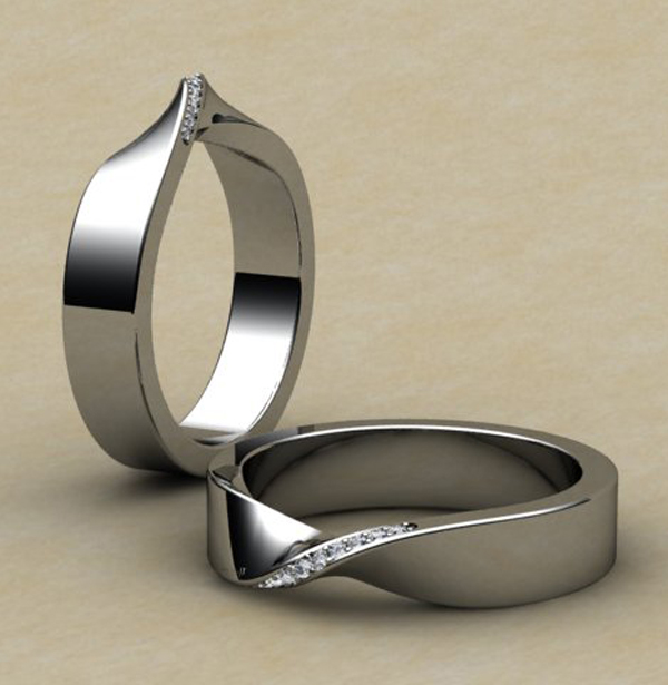 Mobius wedding ring in 18ct white gold and set with tiny diamonds in