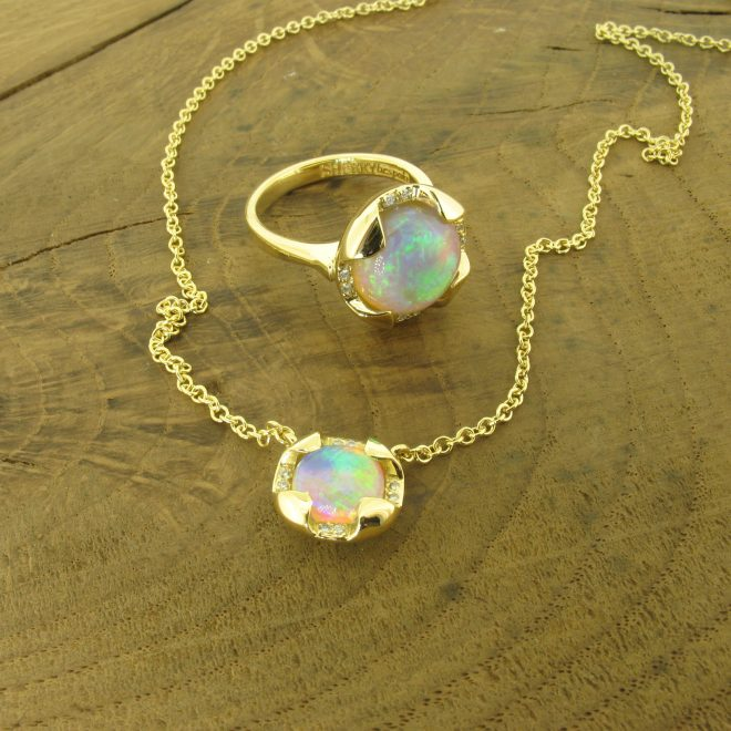 Opal and diamond suite in 18ct yellow gold