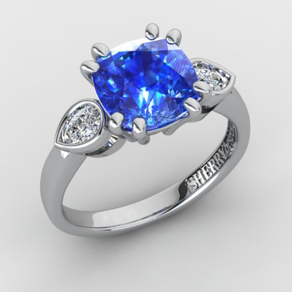 Sapphire and pear cut diamond ring